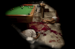 Esteban Feliz (Peru) - Two bodies lie on the floor in a pool hall, after an attack by unidentified Honduran masked assailants in Choloma, on the outskirts of San Pedro Sula, Honduras.