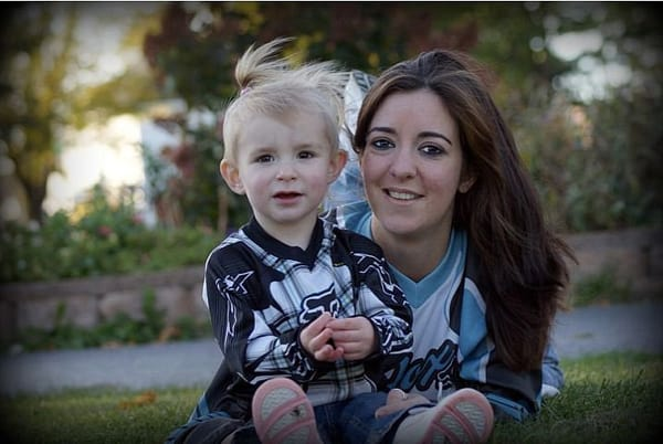 Kori Sherwood, pictured here with her daughter, recently lost her job as a millwright at a U.S. Steel plant in Minnesota when it closed, citing an international glut of steel.