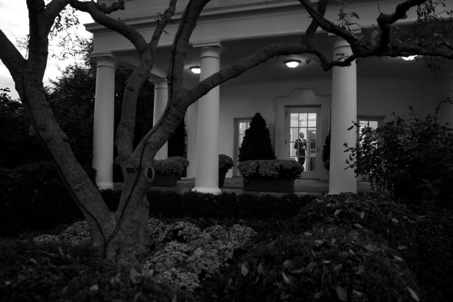 President Obama is seen from the Rose Garden walking through the Oval Office. White House official photo by Pete Souza.